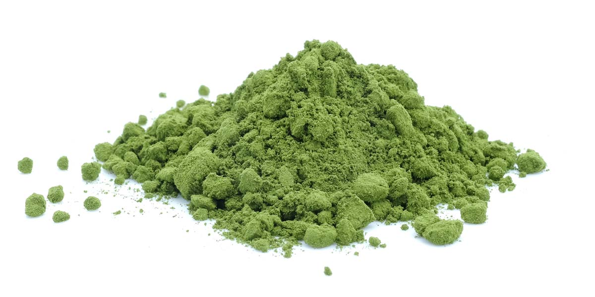 Green tea powder on white background.